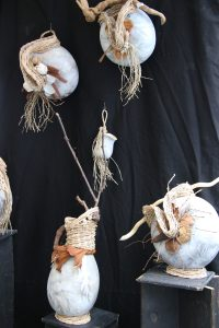 white and grey gourd-shaped vases decorated with brown fibers