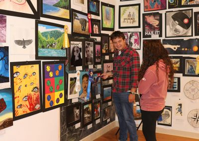 Two young festival attendees admireyoung emerging artist works at the Colorscape Chenango Arts Festival