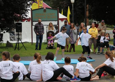 Two young dancers perform to a crowd of attendees at the Colorscape Chenango Arts Festival