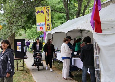 Festival attendees browse the Literary Arts tents at the Colorscape Chenango Arts Festival