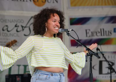 A young female performer on stage at the Colorscape Chenango Arts Festival