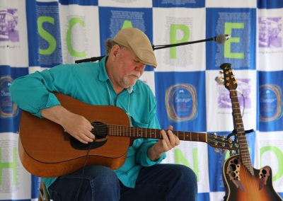 A guitar player performs at the Colorscape Chenango Arts Festival