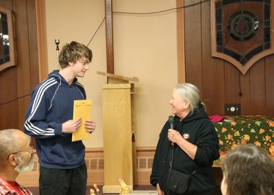 A young artist is presented with an award at the Colorscape Chenango Arts Festival artist breakfast