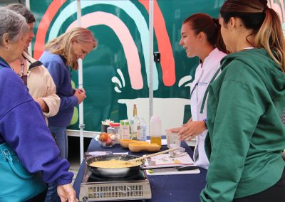 Two Culinary vendors show festival attendees their process at the Colorscape Chenango Arts Festival