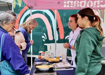 Festival attendees check out the Chobani culinary tent at the Colorscape Chenango Arts Festival