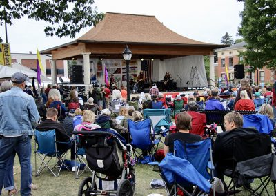A large crowd gathers to hear music at the Colorscape Chenango Arts Festival