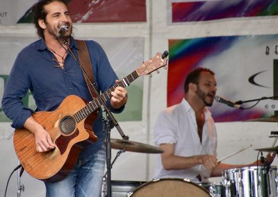 A guitarist and drummer perform at the Colorscape Chenango Arts Festival