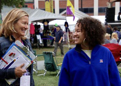 Two women smile at the Colorscape Chenango Arts Festival